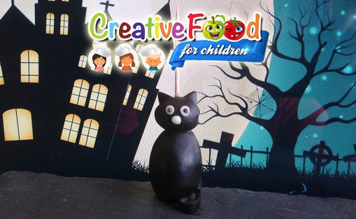 Gatto nero con oliva