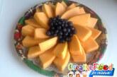 Girasole di frutta melone e mirtilli